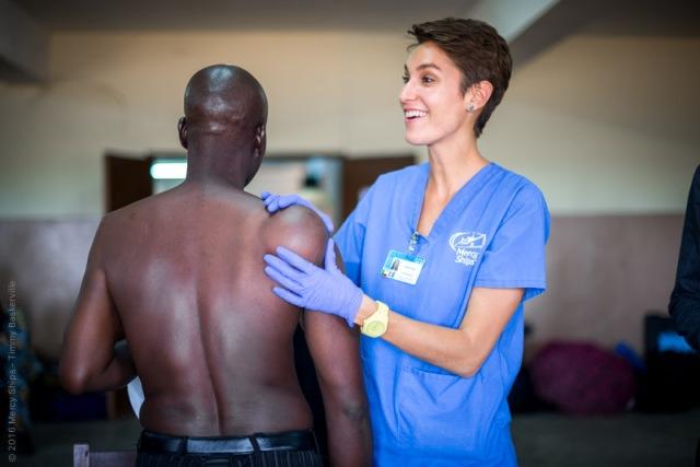 Nurse Kayla Innis examining patient during screening process.